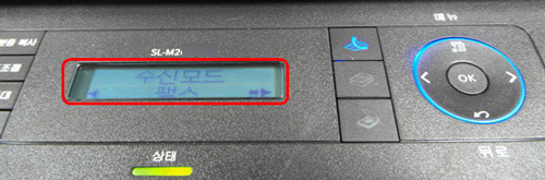 조작판 액정화면에 수신모드를 팩스로 선택하는 예시 화면
